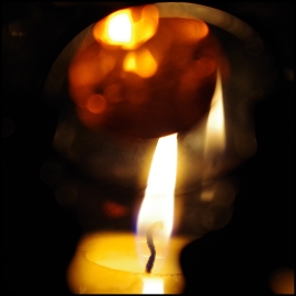 Candle flame with reflection