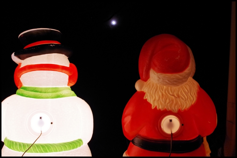 Frosty and Santa, admiring the full moon.