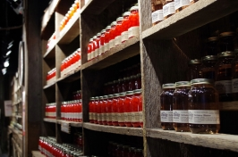 Mason jars of cherries in moonshine line the shelves.