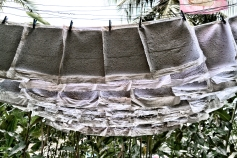 handmade paper is hung to dry in the sun. ©Sharon Popek 2016