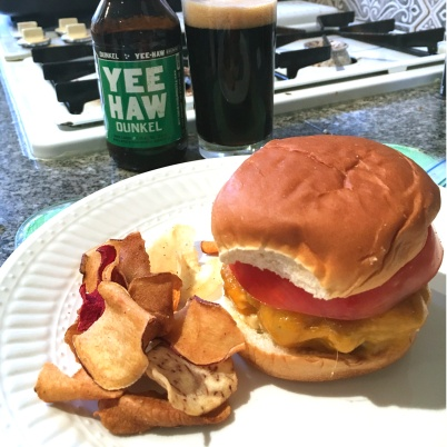 Burger with Terra chips and beer